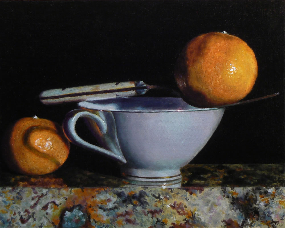 Teacup, Fork, and Two Oranges on Granite