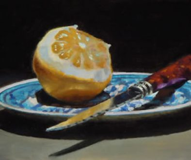 peeled_orange_knife_blue_plate